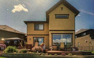 Photo 2: 36 Quarry Gardens SE in Calgary: Douglasdale/Glen Detached for sale : MLS®# A1074544