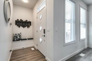 Photo 3: 618 148 Avenue NW in Calgary: Livingston Detached for sale : MLS®# A1149681