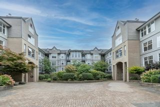 """Photo 1: 418 20200 56 Avenue in Langley: Langley City Condo for sale in """"The Bentley"""" : MLS®# R2612612"""