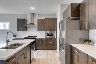 Photo 5: 8 Walgrove Landing SE in Calgary: Walden Detached for sale : MLS®# A1145255