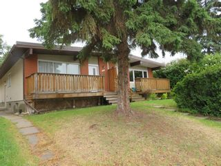 Photo 2: 75 GALBRAITH Drive SW in Calgary: Glamorgan Semi Detached for sale : MLS®# C4254866