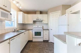 Photo 6: 1106 PRAIRIE SOUND Circle NW: High River Row/Townhouse for sale : MLS®# C4239510