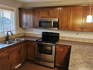 Photo 2: 8406 87 Street in Fort St. John: Fort St. John - City SE 1/2 Duplex for sale (Fort St. John (Zone 60))  : MLS®# R2564392