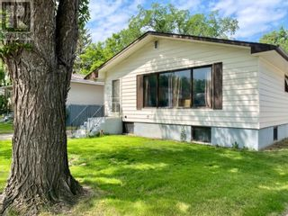 Photo 2: 415 3A Street W in Brooks: House for sale : MLS®# A1129371