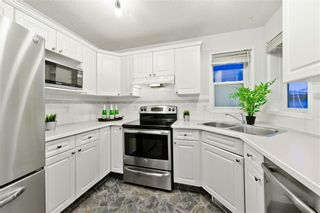 Photo 5: 167 BRIDLEWOOD CM SW in Calgary: Bridlewood House for sale