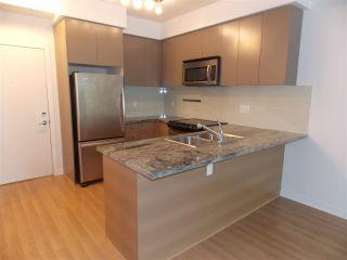 "Photo 2: 311 6420 194 Street in Surrey: Clayton Condo for sale in ""WATERSTONE"" (Cloverdale)  : MLS®# R2575596"