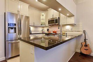 Photo 8: 409 12655 190A STREET in Pitt Meadows: Mid Meadows Condo for sale : MLS®# R2225101