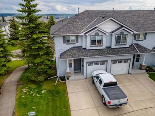Photo 3: 112 Rocky Vista Circle NW in Calgary: Rocky Ridge Row/Townhouse for sale : MLS®# A1125808
