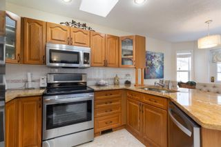 Photo 5: 144 Harrison Court: Crossfield Detached for sale : MLS®# A1086558