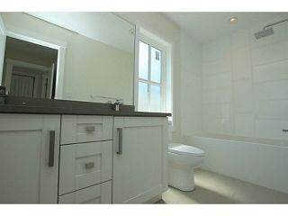 """Photo 10: 101 218 BEGIN Street in Coquitlam: Maillardville House for sale in """"BEGIN SQUARE"""" : MLS®# V1132326"""
