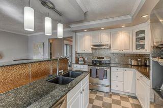 Photo 11: 164 Parkridge Place SE in Calgary: Parkland Detached for sale : MLS®# A1085419