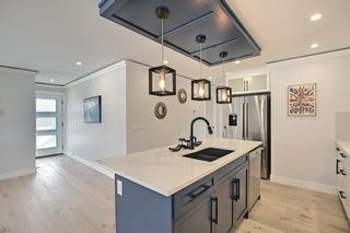 Photo 8: 24 Hyslop Drive SW in Calgary: Haysboro Detached for sale : MLS®# A1141197