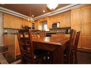 Photo 5: 1591 E 59TH Avenue in Vancouver: Fraserview VE House for sale (Vancouver East)  : MLS®# V1031963