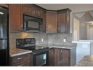 Photo 7: 99 ELGIN MEADOWS Gardens SE in CALGARY: McKenzie Towne Residential Attached for sale (Calgary)  : MLS®# C3545504