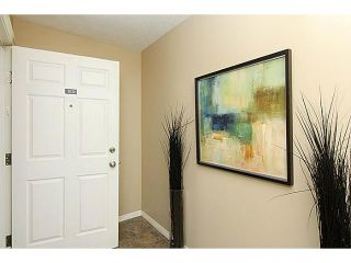 Photo 2: 103 15320 BANNISTER Road SE in CALGARY: Midnapore Condo for sale (Calgary)  : MLS®# C3587093