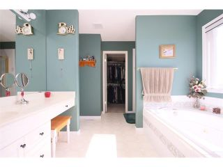 Photo 34: 51 GLENEAGLES View: Cochrane House for sale : MLS®# C4008842
