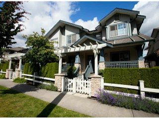 """Photo 1: 15 19250 65TH Avenue in Surrey: Clayton Townhouse for sale in """"Sunberry Court"""" (Cloverdale)  : MLS®# F1416410"""