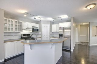 Photo 4: 11546 Tuscany Boulevard NW in Calgary: Tuscany Detached for sale : MLS®# A1136936
