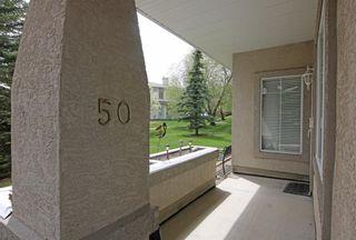 Photo 3: 50 Edgeridge Terrace NW in Calgary: Edgemont Row/Townhouse for sale : MLS®# A1111203