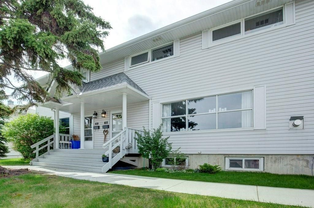 Photo 1: Photos: 615 Merrill Drive NE in Calgary: Winston Heights/Mountview Row/Townhouse for sale : MLS®# C4301720