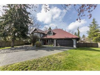 "Photo 1: 7549 150A Street in Surrey: East Newton House for sale in ""Chimney Hills"" : MLS®# R2561314"