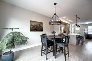 Photo 9: 374 Quarry Park Boulevard SE in Calgary: Douglasdale/Glen Row/Townhouse for sale : MLS®# A1063797