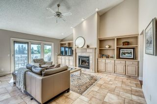 Photo 12: 555 Coach Light Bay SW in Calgary: Coach Hill Detached for sale : MLS®# A1144688