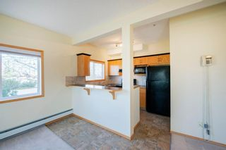 Photo 6: 101 72 Quigley Drive: Cochrane Apartment for sale : MLS®# A1091486