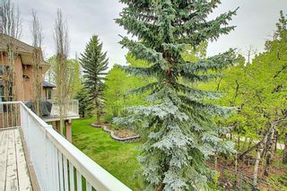 Photo 13: 12 Strathlea Place SW in Calgary: Strathcona Park Detached for sale : MLS®# A1114474