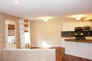 Photo 11: 7 Cougarstone Circle SW in Calgary: Cougar Ridge Detached for sale : MLS®# A1147627