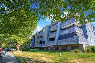 "Photo 1: 211 5906 176A Street in Surrey: Cloverdale BC Condo for sale in ""Wyndam Estates"" (Cloverdale)  : MLS®# R2496139"