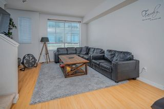 """Photo 2: 19 301 KLAHANIE Drive in Port Moody: Port Moody Centre Townhouse for sale in """"THE CURRENTS"""" : MLS®# R2601423"""