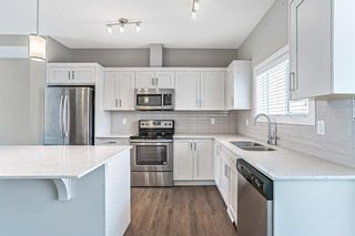 Photo 5: 536 Cranford Drive SE in Calgary: Cranston Row/Townhouse for sale : MLS®# A1097565