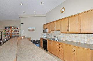 Photo 24: 2108 92 Crystal Shores Road: Okotoks Apartment for sale : MLS®# A1068226