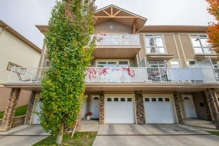 Main Photo: 2 172 Rockyledge View NW in Calgary: Rocky Ridge Row/Townhouse for sale : MLS®# A1152738