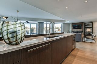 Photo 8: 501 128 Waterfront Court SW in Calgary: Chinatown Apartment for sale : MLS®# A1107113