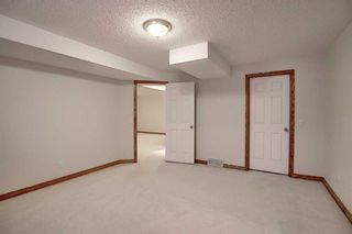 Photo 30: 13 Strathearn Gardens SW in Calgary: Strathcona Park Semi Detached for sale : MLS®# A1114770