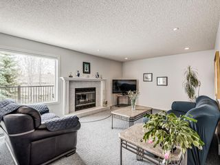 Photo 16: 54 Signature Close SW in Calgary: Signal Hill Detached for sale : MLS®# A1138139
