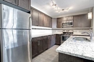 Photo 3: 555 Redstone View NE in Calgary: Redstone Row/Townhouse for sale : MLS®# A1149779