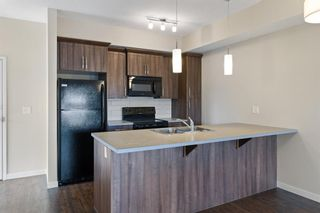 Photo 6: 9308 101 Sunset Drive: Cochrane Apartment for sale : MLS®# A1141889