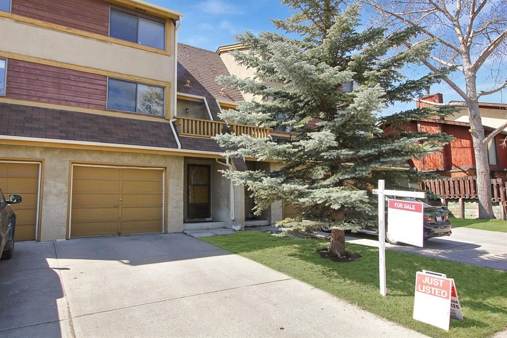 Main Photo: 1433 Ranchlands Road NW in Calgary: Ranchlands Row/Townhouse for sale : MLS®# A1128096