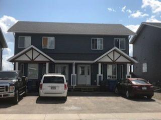 Photo 1: 9211 102 Avenue in Fort St. John: Fort St. John - City NE 1/2 Duplex for sale (Fort St. John (Zone 60))  : MLS®# R2229819