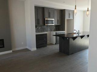 Photo 7: 23 Sunrise Heights: Cochrane Duplex for sale : MLS®# A1017998