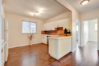 Photo 6: 3123 40 Street SW in Calgary: Attached for sale : MLS®# C4035349