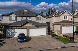 Photo 1: 124 CASTLE Drive in Edmonton: Zone 27 House Half Duplex for sale : MLS®# E4260271