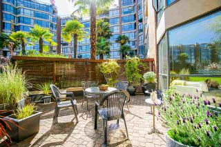 """Photo 1: 108 1450 PENNYFARTHING Drive in Vancouver: False Creek Condo for sale in """"HARBOUR COVE"""" (Vancouver West)  : MLS®# R2459679"""