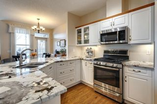 Photo 14: 56 Tuscany Village Court NW in Calgary: Tuscany Semi Detached for sale : MLS®# A1079076