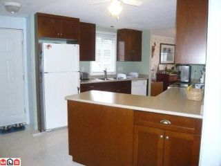 """Photo 3: 38 8254 134 Street in Surrey: Queen Mary Park Surrey Manufactured Home for sale in """"Westwood Estates"""" : MLS®# F1102670"""
