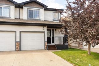 Main Photo: 210 Ibbotson Close: Red Deer Semi Detached for sale : MLS®# A1146280