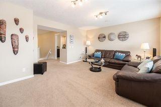 Photo 14: 325 BRIDLERIDGE View SW in Calgary: Bridlewood House for sale : MLS®# C4177139
